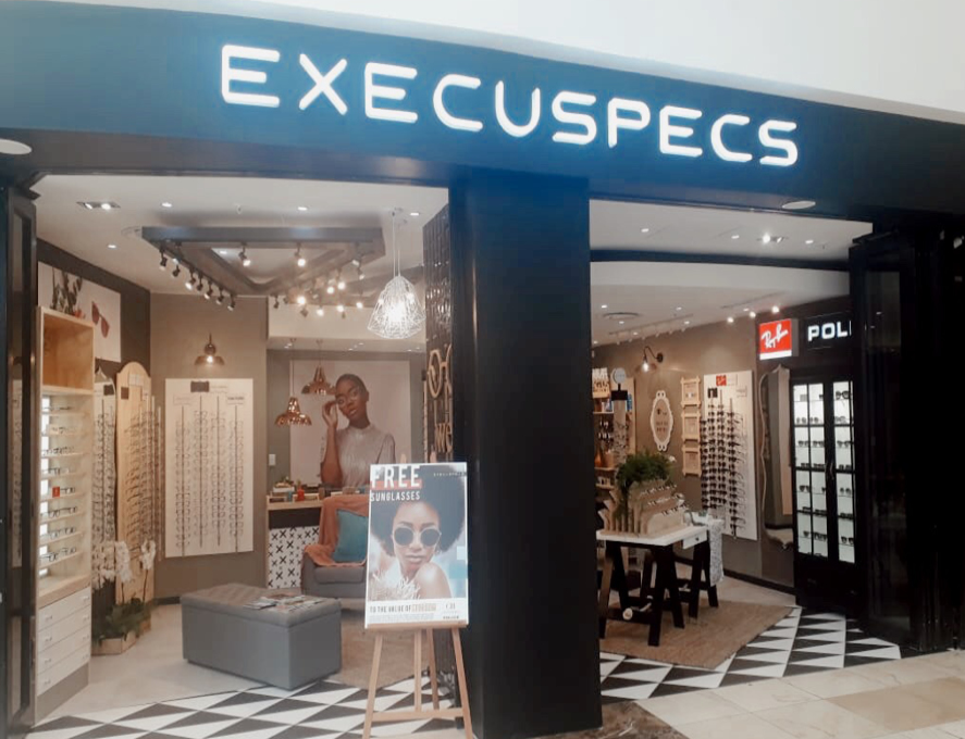 Execuspecs The Grove Mall offers vision screening, eye tests, quality prescription spectacles, readers, contact lenses and designer sunglasses in-store and online in Windhoek, Namibia. Accepts most medical aids. Discovery member get 20% off their frames and lenses. Kids between 6 and 9 years of age qualify for free test, frames and lenses.